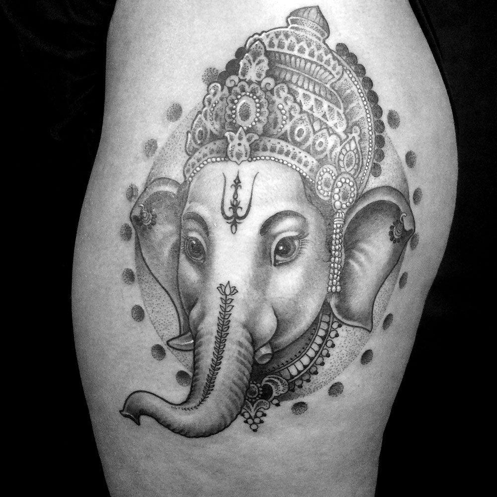 Feminine hip Ganesh tattoo - Mark Nara -